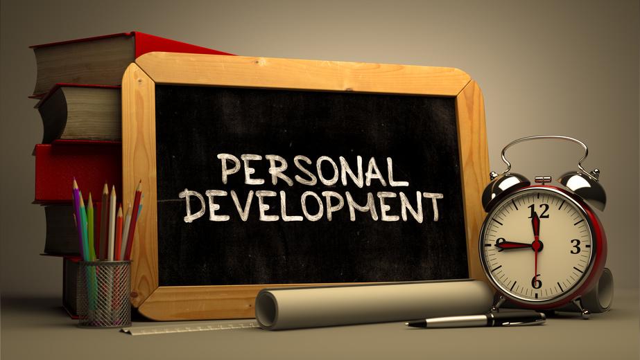 Hand Drawn Personal Development Concept on Chalkboard.