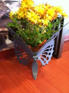 Butterfly plant holder yellow flowers